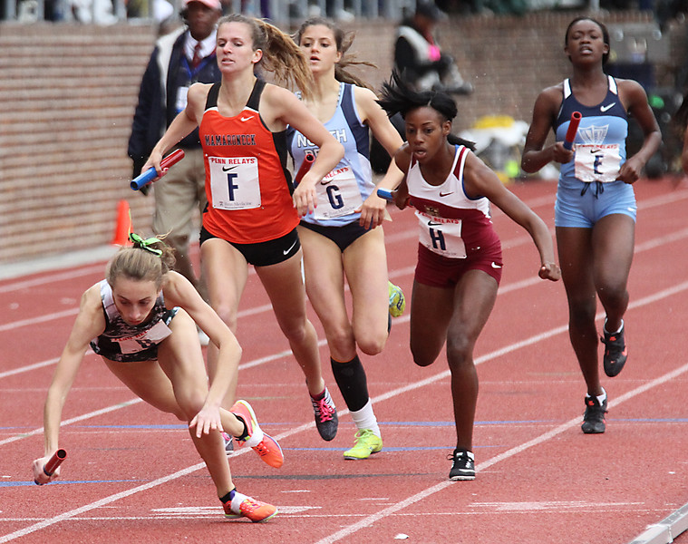 ROBERT GURECKI   -   DIGITAL FIRST MEDIA.<br /> Hannah Reale of Shanendehowa, left, takes a spill in the 4xz800 COA relay at the Penn Relays in Philadelphia but the team recovered and won the event