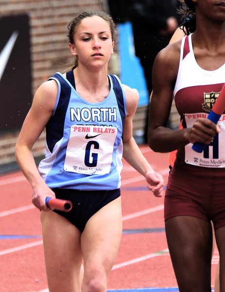 ROBERT GURECKI   -   DIGITAL FIRST MEDIA.<br /> North Penn runner in the 4 x 800 COA at the Penn Relays (No name available).