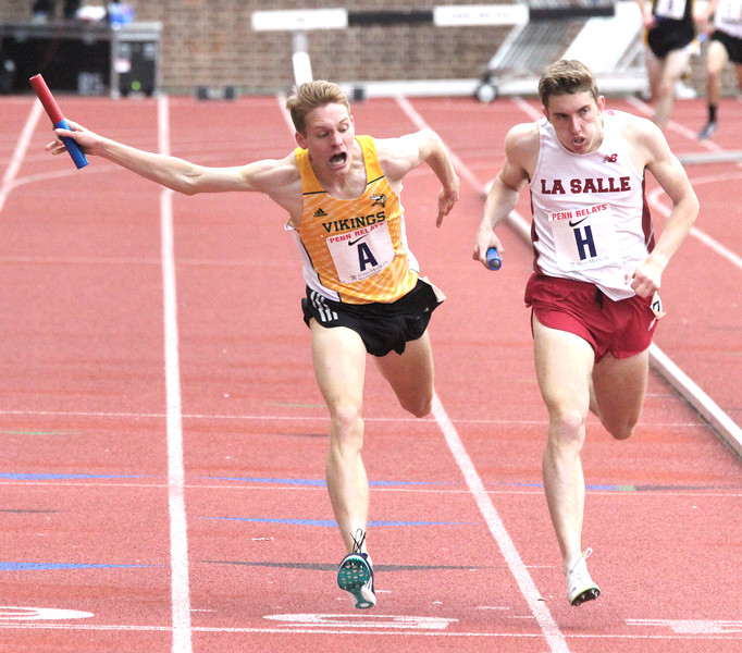 ROBERT GURECKI   -   DIGITAL FIRST MEDIA.<br /> LaSalle Academy's Jack Salisbury, right, tries to take the last step to win the HSB Distance Medley COA but Loudoun Valley's Drew Hunter.