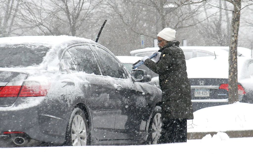 . Gene Walsh � Digital First Media Motorist clears their car off along DeKalb Pike in East Norriton March 21, 2018.