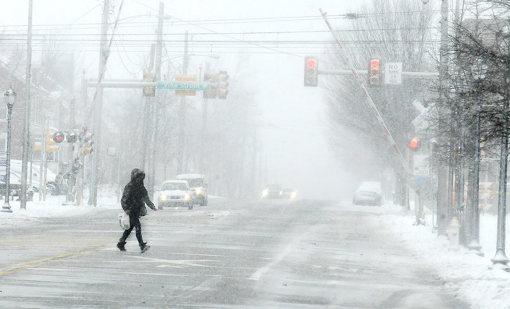 . Gene Walsh � Digital First Media Pedestrians and motorists alike brave the wintery conditions along Broad Street in Lansdale March 21, 2018.