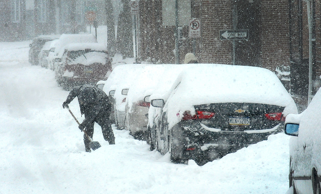 . Gene Walsh � Digital First Media Motorist works to dig out his car on N. York Street in Pottstown March 21, 2018.