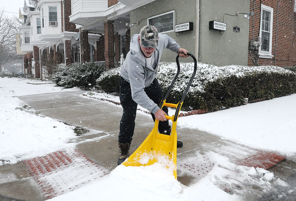 . Gene Walsh � Digital First Media Bobby Byrnes shovels the snow away from the sidewalk along Furnace Street in Norristown March 21, 2018