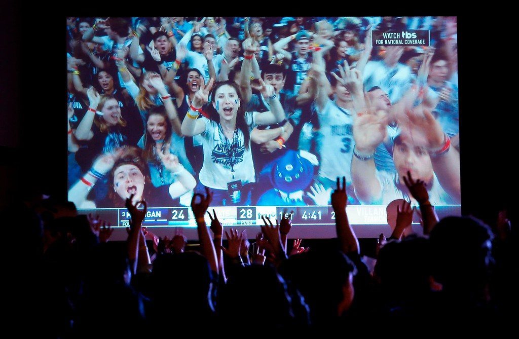 . Villanova fans cheer during the first half of the broadcast of the national NCAA college basketball championship between Villanova and Michigan, Monday, April 2, 2018, in Villanova, Pa. (AP Photo/Laurence Kesterson)