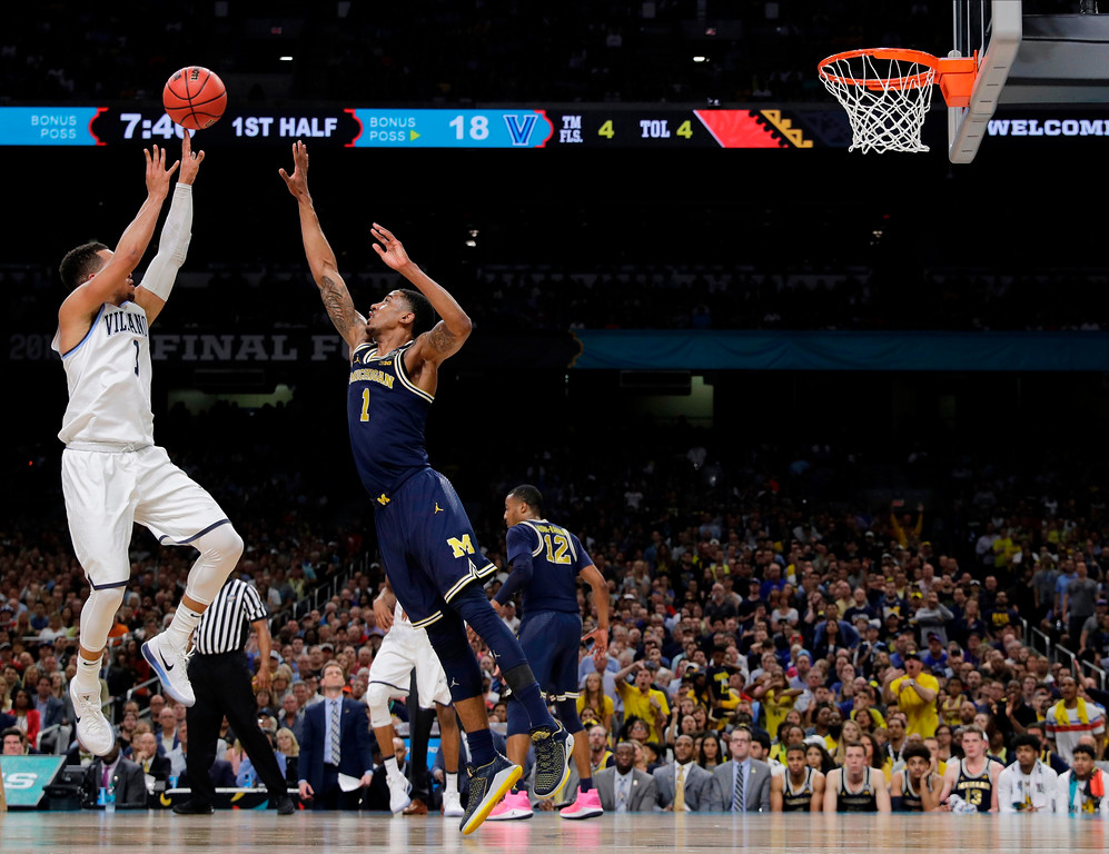 . Villanova\'s Jalen Brunson, left, shoots over Michigan\'s Charles Matthews during the first half in the championship game of the Final Four NCAA college basketball tournament, Monday, April 2, 2018, in San Antonio. (AP Photo/Eric Gay)