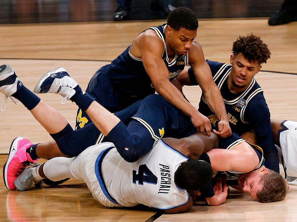 . Villanova\'s Eric Paschall (4) and Michigan\'s Moritz Wagner battle for the loose ball during the first half in the championship game of the Final Four NCAA college basketball tournament, Monday, April 2, 2018, in San Antonio. (AP Photo/Brynn Anderson)