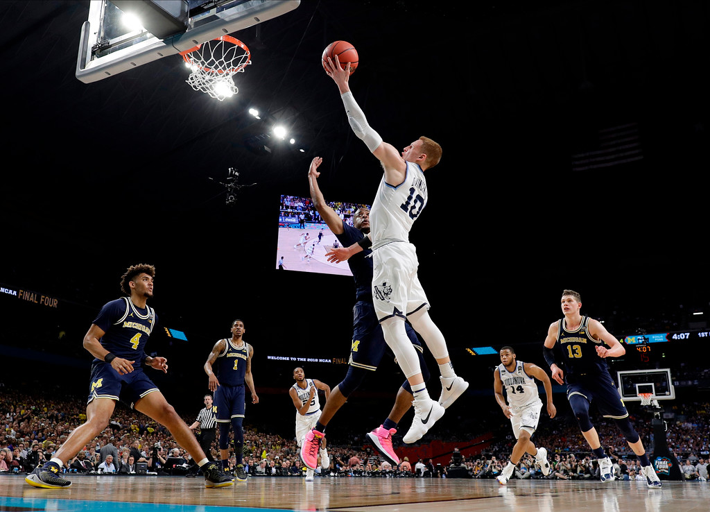 . Villanova\'s Donte DiVincenzo (10) shoots against =Michigan\'s Muhammad-Ali Abdur-Rahkman during the first half in the championship game of the Final Four NCAA college basketball tournament, Monday, April 2, 2018, in San Antonio. (AP Photo/Eric Gay)