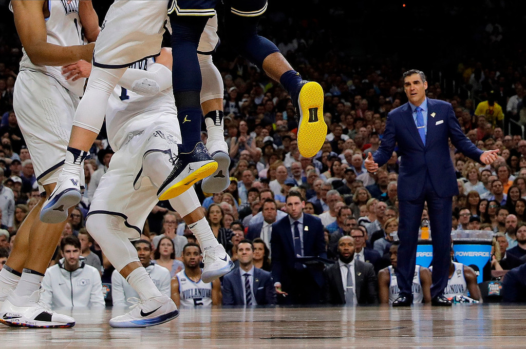 . Villanova head coach Jay Wright watches his players during the first half in the championship game of the Final Four NCAA college basketball tournament against Michigan, Monday, April 2, 2018, in San Antonio. (AP Photo/David J. Phillip)