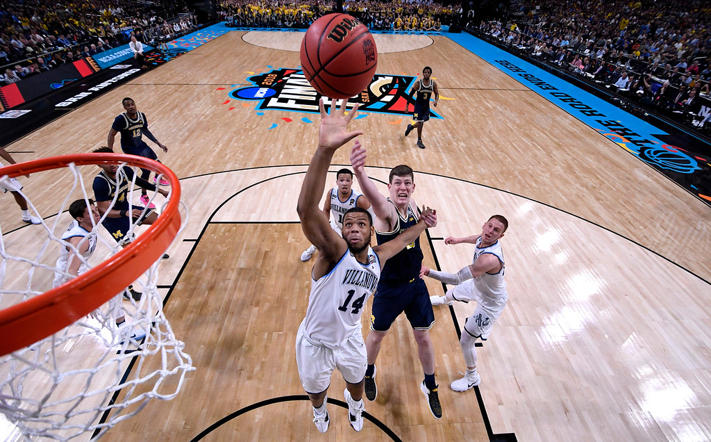 . Villanova forward Omari Spellman (14) drives to the basket ahead of Michigan center Jon Teske during the first half in the championship game of the Final Four NCAA college basketball tournament, Monday, April 2, 2018, in San Antonio. (AP Photo/Chris Steppig, NCAA Photos Pool)