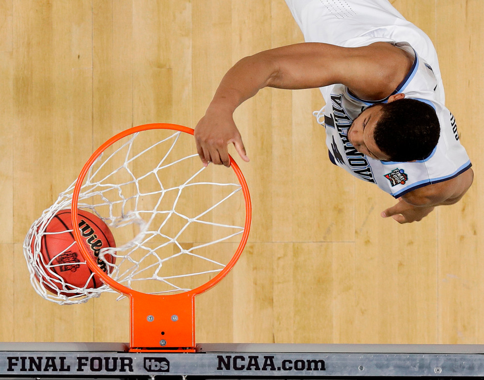 . Villanova forward Omari Spellman dunks the ball during the first half against Michigan in the championship game of the Final Four NCAA college basketball tournament, Monday, April 2, 2018, in San Antonio. (AP Photo/Eric Gay)