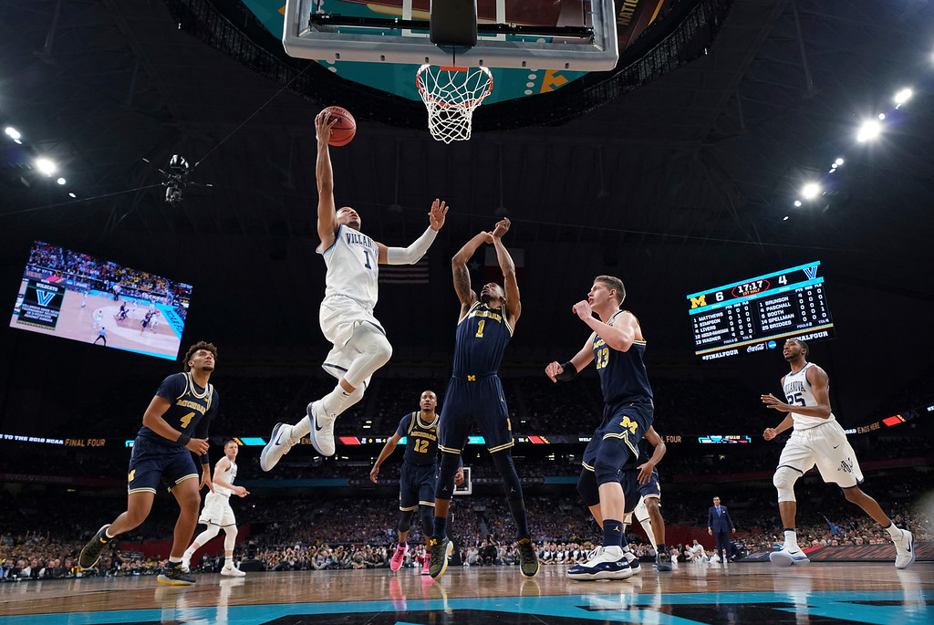 . Villanova\'s Jalen Brunson goes up for a shot over Michigan\'s Charles Matthews during the first half in the championship game of the Final Four NCAA college basketball tournament, Monday, April 2, 2018, in San Antonio. (AP Photo/Chris Steppig, NCAA Photos Pool)