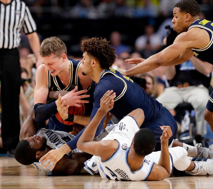 . Villanova\'s Eric Paschall (4) and Michigan\'s Moritz Wagner battles for the loose ball during the first half in the championship game of the Final Four NCAA college basketball tournament, Monday, April 2, 2018, in San Antonio. (AP Photo/Eric Gay)