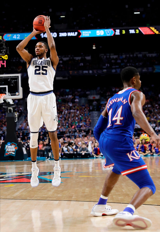 . Villanova guard Mikal Bridges shoots a 3-point basket in front of Kansas guard Malik Newman, right, during the second half in the semifinals of the Final Four NCAA college basketball tournament, Saturday, March 31, 2018, in San Antonio. (AP Photo/David J. Phillip)