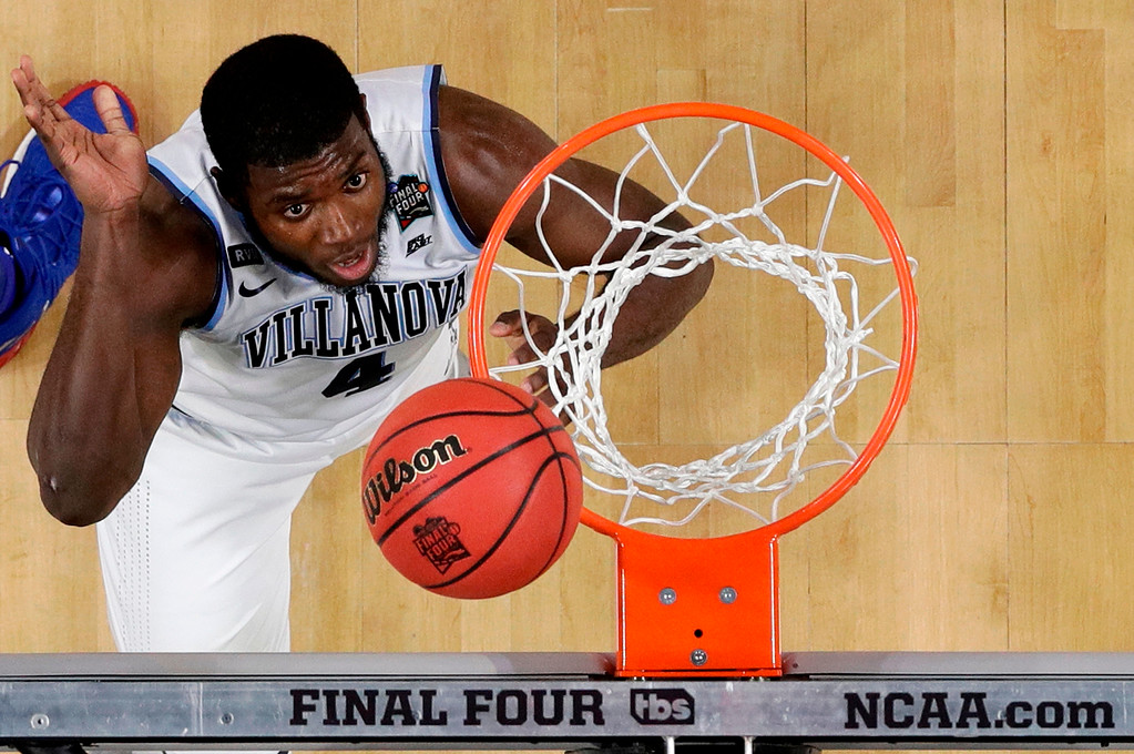 . Villanova forward Eric Paschall drives to the basket during the second half against Kansas in the semifinals of the Final Four NCAA college basketball tournament, Saturday, March 31, 2018, in San Antonio. (AP Photo/David J. Phillip)