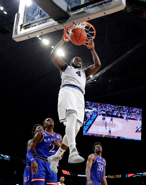. Villanova\'s Eric Paschall (4) dunks during the second half in the semifinals of the Final Four NCAA college basketball tournament against Kansas, Saturday, March 31, 2018, in San Antonio. (AP Photo/David J. Phillip)