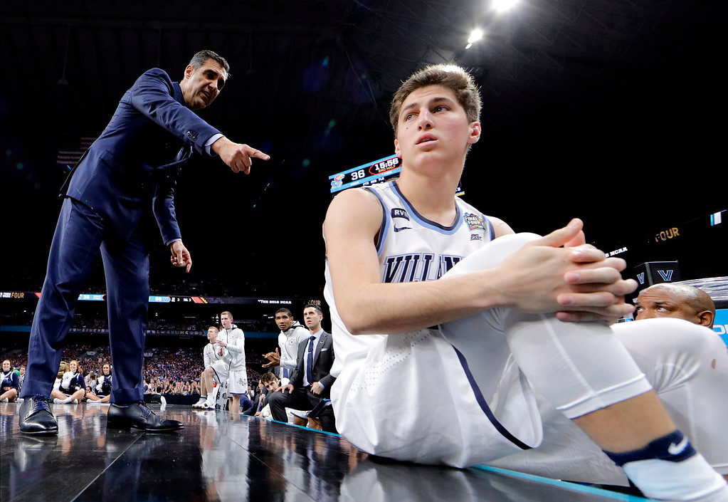 . Villanova head coach Jay Wright talks to guard Collin Gillespie during the second half against Kansas in the semifinals of the Final Four NCAA college basketball tournament, Saturday, March 31, 2018, in San Antonio. (AP Photo/David J. Phillip)