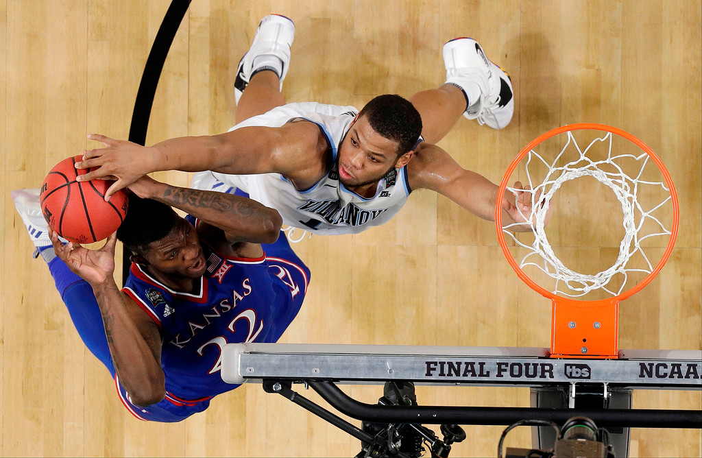 . Villanova\'s Omari Spellman (14) blocks a shot by Kansas\'s Silvio De Sousa (22) during the second half in the semifinals of the Final Four NCAA college basketball tournament, Saturday, March 31, 2018, in San Antonio. (AP Photo/Eric Gay)