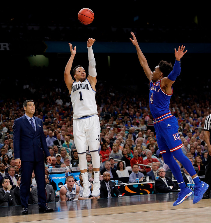 . Villanova\'s Jalen Brunson (1) shoots a 3-point basket against Kansas\'s Devonte\' Graham (4) during the second half in the semifinals of the Final Four NCAA college basketball tournament, Saturday, March 31, 2018, in San Antonio. (AP Photo/David J. Phillip)