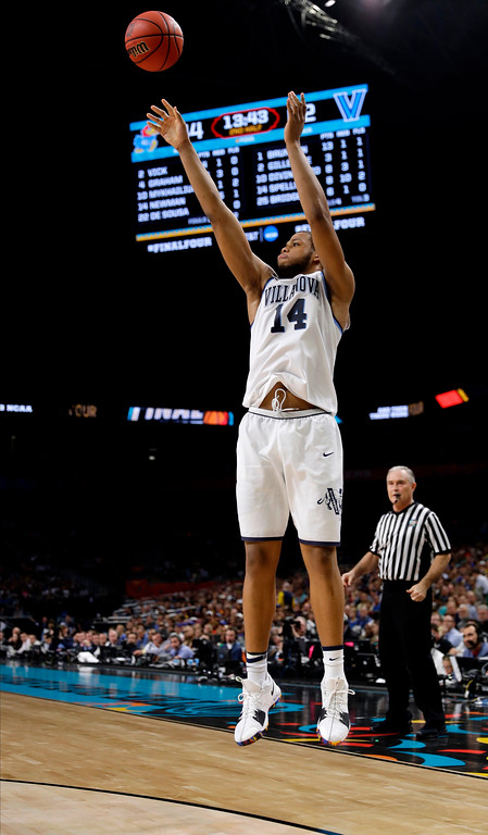 . Villanova\'s Omari Spellman (14) shoots a 3-point basket against Kansas during the second half in the semifinals of the Final Four NCAA college basketball tournament, Saturday, March 31, 2018, in San Antonio. (AP Photo/David J. Phillip)