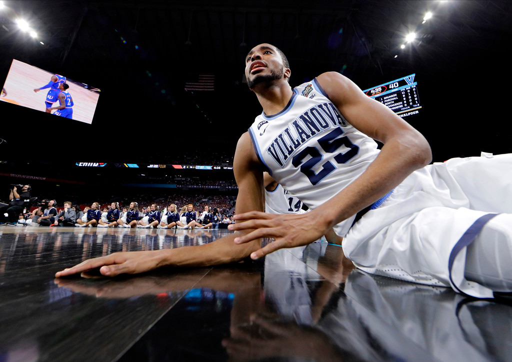 . Villanova guard Mikal Bridges watches from the bench during the first half against Kansas in the semifinals of the Final Four NCAA college basketball tournament, Saturday, March 31, 2018, in San Antonio. (AP Photo/David J. Phillip)