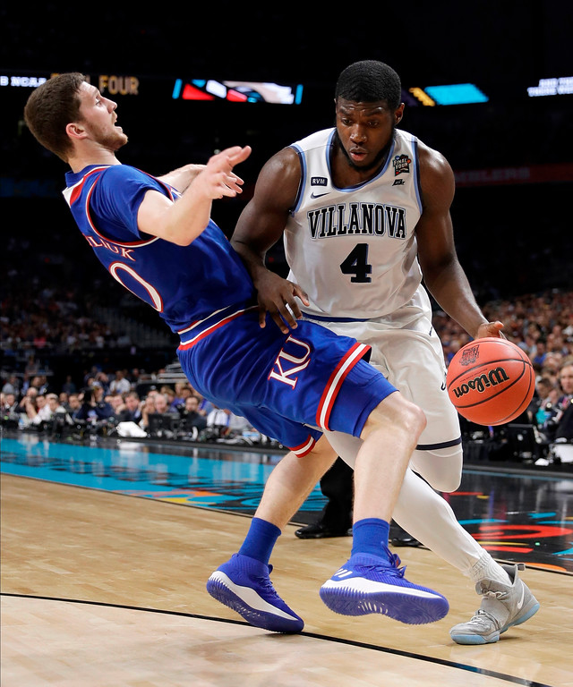 . Villanova\'s Eric Paschall (4) drives against Kansas\'s Sviatoslav Mykhailiuk during the second half in the semifinals of the Final Four NCAA college basketball tournament, Saturday, March 31, 2018, in San Antonio. (AP Photo/David J. Phillip)
