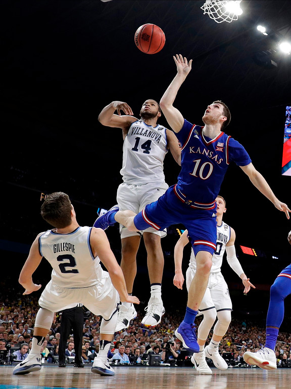 . Kansas\'s Sviatoslav Mykhailiuk (10) shoots against Villanova\'s Collin Gillespie (2) and Omari Spellman (14) during the second half in the semifinals of the Final Four NCAA college basketball tournament, Saturday, March 31, 2018, in San Antonio. (AP Photo/Eric Gay)