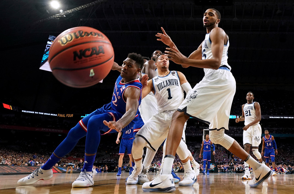 . Kansas forward Silvio De Sousa, left, fights for a loose ball with Villanova\'s Jalen Brunson (1) and Mikal Bridges, right, during the first half in the semifinals of the Final Four NCAA college basketball tournament, Saturday, March 31, 2018, in San Antonio. (AP Photo/Chris Steppig, NCAA Photos Pool)