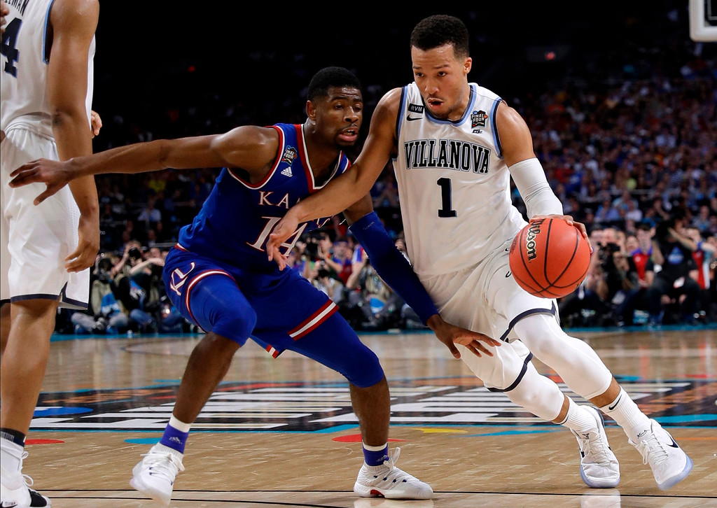 . Villanova guard Jalen Brunson (1) drives past Kansas guard Malik Newman during the second half in the semifinals of the Final Four NCAA college basketball tournament, Saturday, March 31, 2018, in San Antonio. (AP Photo/David J. Phillip)