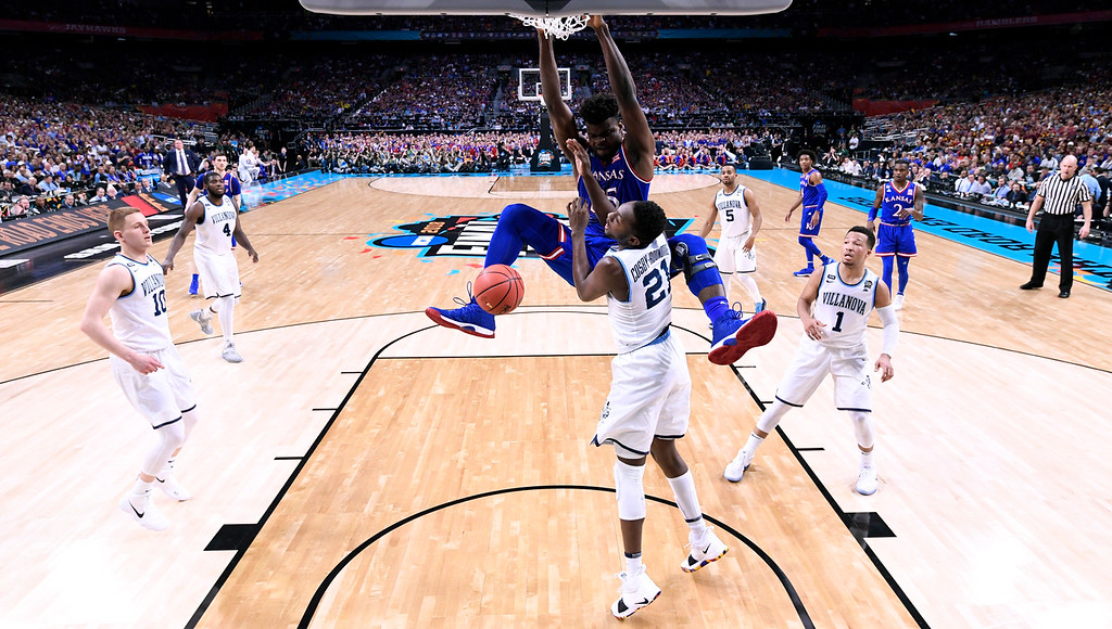 . Kansas center Udoka Azubuike dunks over Villanova forward Dhamir Cosby-Roundtree (21) during the first half in the semifinals of the Final Four NCAA college basketball tournament, Saturday, March 31, 2018, in San Antonio. (AP Photo/Chris Steppig, NCAA Photos Pool)