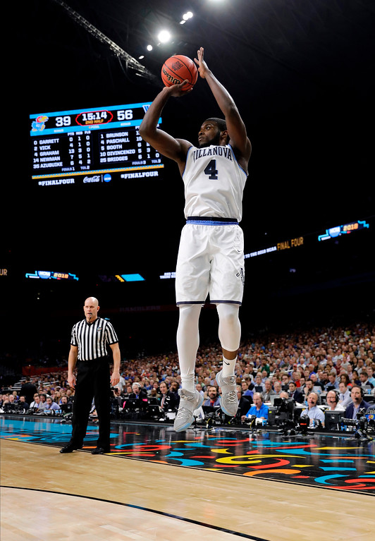. Villanova forward Eric Paschall shoots a 3-point basket during the second half against Kansas in the semifinals of the Final Four NCAA college basketball tournament, Saturday, March 31, 2018, in San Antonio. (AP Photo/David J. Phillip)