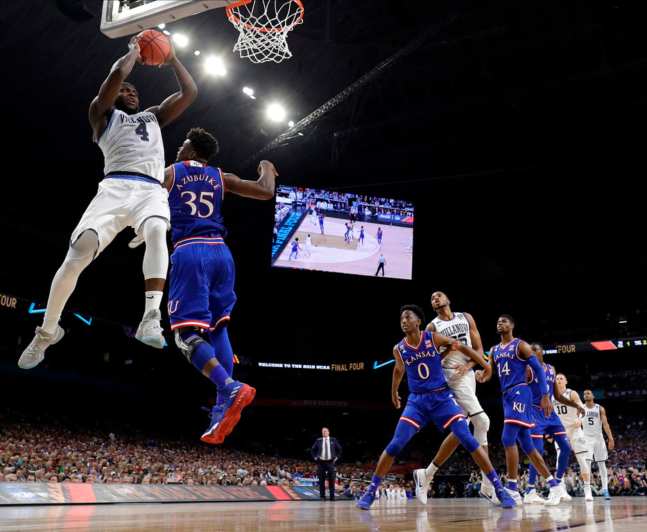 . Villanova\'s Eric Paschall (4) goes up for a shot against Kansas\'s Udoka Azubuike (35) during the second half in the semifinals of the Final Four NCAA college basketball tournament, Saturday, March 31, 2018, in San Antonio. (AP Photo/David J. Phillip)