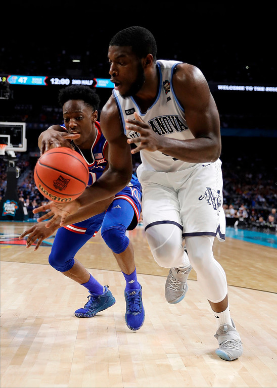 . Villanova\'s Eric Paschall, right, battles for the ball against Kansas\'s Marcus Garrett during the second half in the semifinals of the Final Four NCAA college basketball tournament, Saturday, March 31, 2018, in San Antonio. (AP Photo/David J. Phillip)