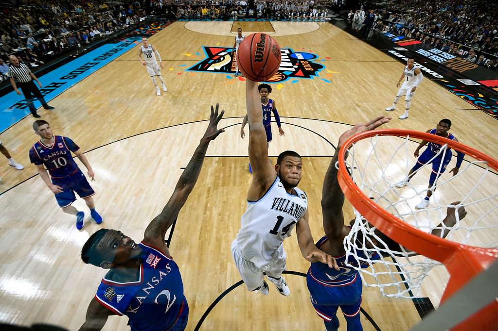 . Villanova\'s Omari Spellman (14) shoots over Kansas\'s Lagerald Vick (2) and Silvio De Sousa (22) during the first half in the semifinals of the Final Four NCAA college basketball tournament, Saturday, March 31, 2018, in San Antonio. (AP Photo/Chris Steppig, NCAA Photos Pool)