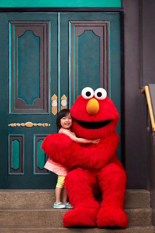 . Elmo & Girl on Steps