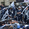 PETE  BANNAN-DIGITAL FIRST MEDIA     Coach Jay Wright and the Villanova Wildcat basketball team enjoy a final streamer celebration at City Hall Thursday.