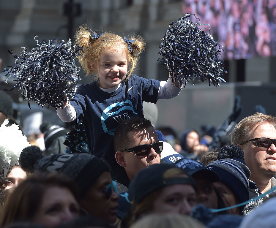 . PETE  BANNAN-DIGITAL FIRST MEDIA      Fiona Fahy,3, cousin of Villanova freshman player Collin Gillespie enjoys the 2018 National Championship celebration at City Hall Thursday.