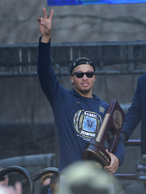 . PETE  BANNAN-DIGITAL FIRST MEDIA       Villanova\'s Jalen Brunson carries the East Regional trophy at the the National Championship celebration.