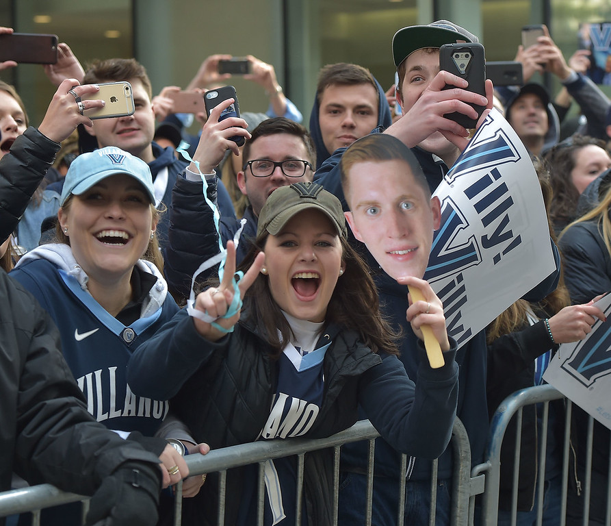 . PETE  BANNAN-DIGITAL FIRST MEDIA        Villanova student Katie Austin enjoys the parade down Market St. in celebration of the 2018 National Championship Thursday.