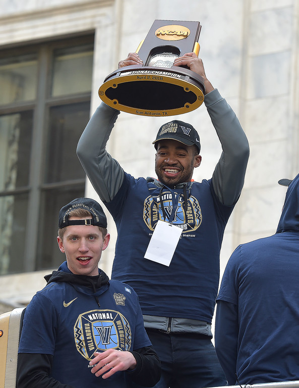 . PETE  BANNAN-DIGITAL FIRST MEDIA       Villanova\'s  team leader Phil Booth holds up the National Championship trophy.