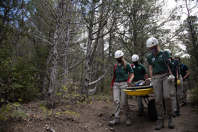 """Rangers bring the """"patient"""" back down Lovers Leap Trail at Philmont Scout Ranch during a search and rescue training on May 26, 2021."""