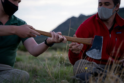 Members of Ranger Leadership gather for opening circle on Wednesday, May 27, 2021. Indidivudals have the opportunity to share words of encouragement and insights with others as they pass around an unsheathed axe marking the beginning of summer.