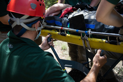 """Rangers prepare to bring the """"patient"""" back down Lovers Leap Trail at Philmont Scout Ranch during a search and rescue training on May 26, 2021."""
