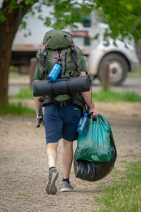 Ranger heading to their tent after getting geared up for the summer season