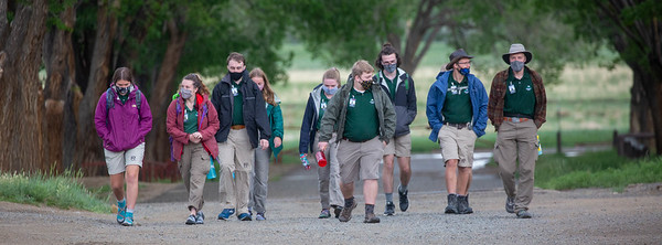 Staff Department walking down the road towards basecamp prepared to take on the 2021 summer season on May 28th, 2021.