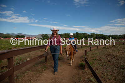Jaclyn Christianson leads a pony ride on Thursday, July 25, 2019 at the Philmont Training Center in Cimarron, New Mexico.