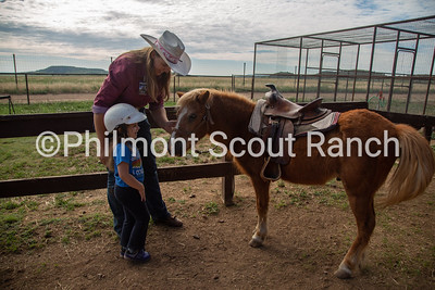 Jaclyn Christianson introduces a PTC participant to the pony Butterscotch on Thursday, July 25, 2019 at the Philmont Training Center in Cimarron, New Mexico.