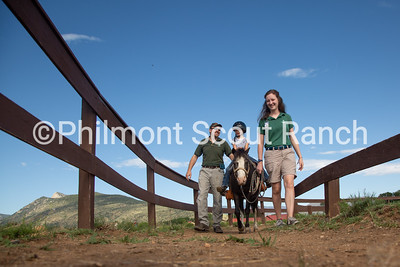 Laura Humpherys leads a pony ride with a staff member's daughter on Thursday, July 25, 2019 at the Philmont Training Center in Cimarron, New Mexico.