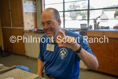 A man holds his leather arrow head he stamped at the Philmont Training Center craft center at Philmont Scout Ranch in Cimarron, New Mexico on Monday, July 29. 2019.