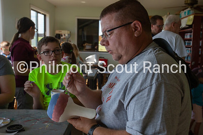 A man paints a ceramics jug at the Philmont Training Center craft center at Philmont Scout Ranch in Cimarron, New Mexico on Monday, July 29. 2019.
