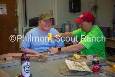 A father and his son are working together to stamp a leather belt at the Philmont Training Center craft center at Philmont Scout Ranch in Cimarron, New Mexico on Monday, July 29. 2019.